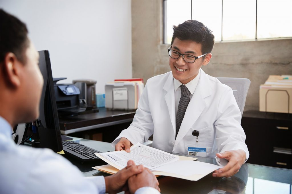 male doctor in consultation with a male patient