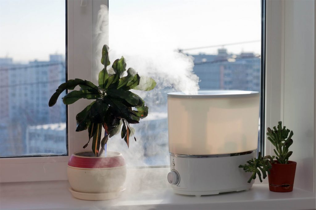 A humidifier by the window helping to keep the air moist and soothes irritation caused by laryngitis